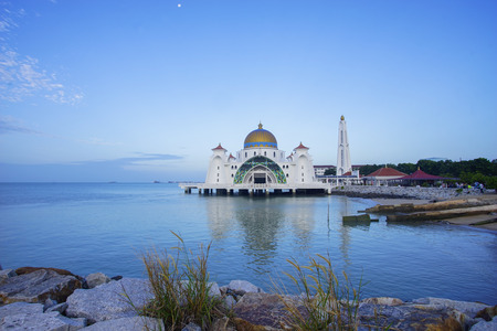 Majestic view of Malacca Straits Mosque during blue hour