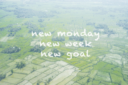 Inspirational quote - New Monday,new week, new goal. Blurry retro style background.