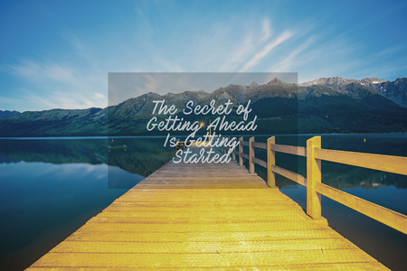 Inspirational success quotes on the mountain sunset. The secret of getting ahead is getting started