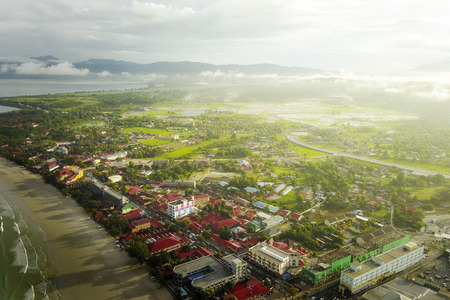 Aerial view of Chenang Beach, Langkawi and village surrounding after sunrise Stock Photo