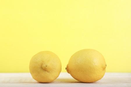 Fresh lemon fruit on wooden and yellow background Stok Fotoğraf