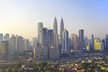 Kuala Lumpur cityscape view after sunrise with beautiful blue sky and side sunlight Stok Fotoğraf