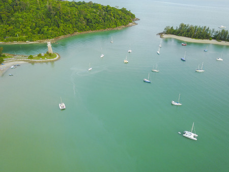 Aerial view of a Lighthouse, boat and yacht docked in marina, Langkawi 免版税图像