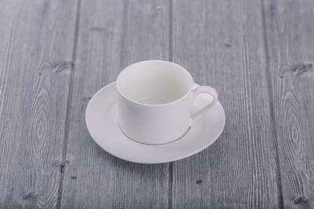 White coffee cup on wooden 免版税图像
