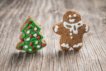 Gingerman and Christmas tree made of gingerbread  as backgorund Stock Photo