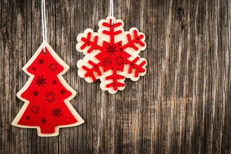 christmastide: Red colored Christmas tree and snowflake decorations