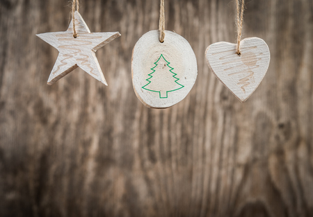 christmastide: Christmas decorations over rustic wooden background
