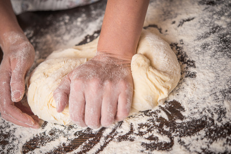 knead: Knead dough with hands Stock Photo