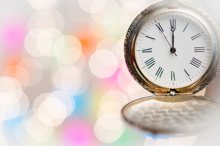New year clock on abstract background Stock Photo
