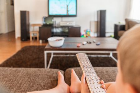 time sensitive: Baby sitting  and holding  TV remote