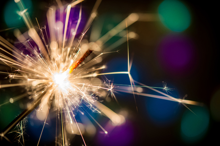 Christmas sparklers and background with colorful bokeh
