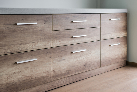 drawers: Wooden kitchen drawers with silver handles Stock Photo