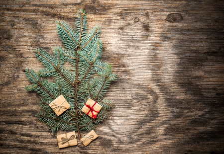 fir branch: Christmas tree made of fir branch on vintage wooden background with copy space Stock Photo