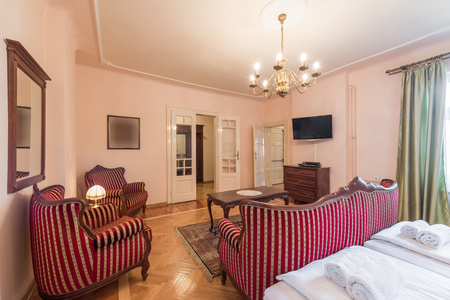 suite: Hotel suite interior with classic style furniture