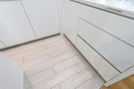 fitted unit: White floor in modern kitchen interior