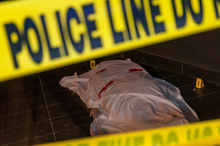 A body on the ground of a crime scene Stock Photo