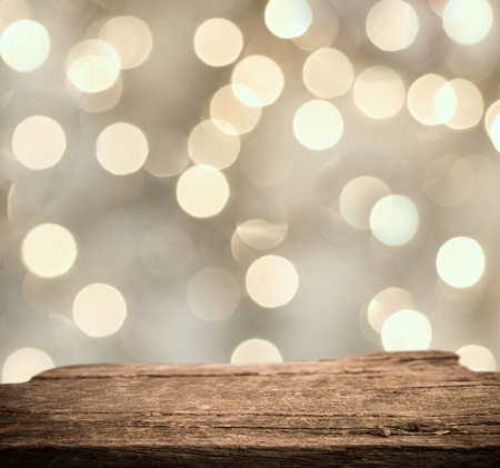 Rrustic wood table in front of glitter and bright bokeh lights Stock Photo
