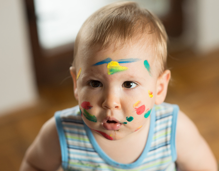 messed: Baby messed with colorful paint