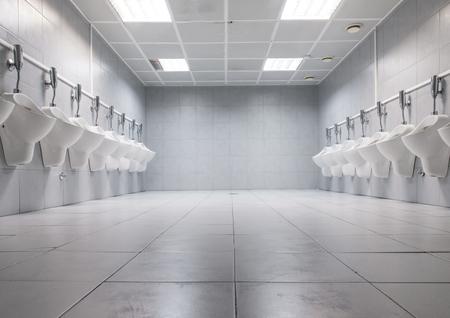 White urinals in mens bathroom
