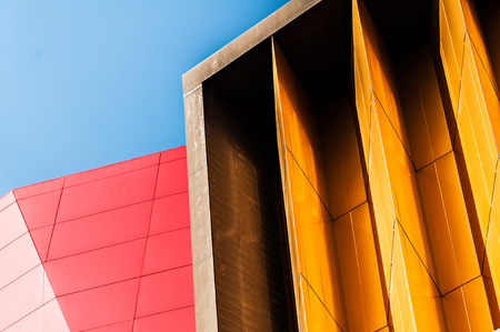 Blue sky red and yellow wall abstract background
