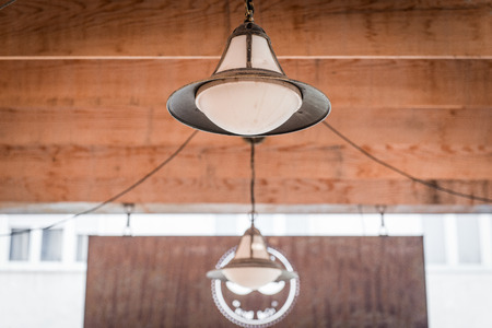carbide: Unusual rustic lamp hanging from ceiling