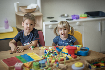 kindy: Pre school kids are playing with montessori toys