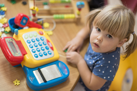 kindy: Cute little girl learning to calculate