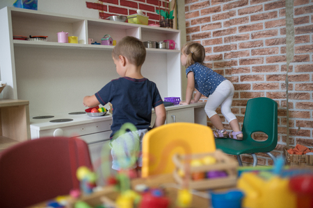 kindy: Kindergarten kitchen toy and kids are playing Stock Photo
