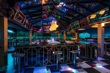 Caffe bar interior with skylight by night
