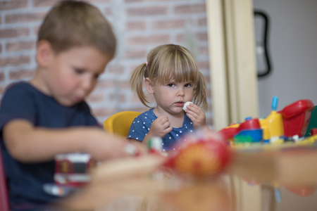 kindy: Curious children playing in kindergarten