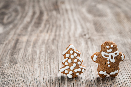 Gingerman and Christmas tree made of gingerbread dough as backgorund
