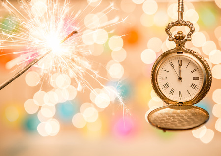 Sparker and clock as holiday background Stock Photo
