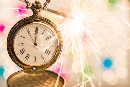 Midnight at clock an sparkler holiday concept Stock Photo