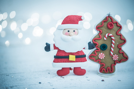 Christmas tree and Santa Claus on bokeh lihgts as holiday card