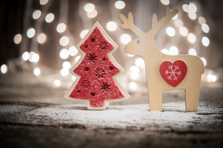 Reindeer and Christmas tree as holiday background
