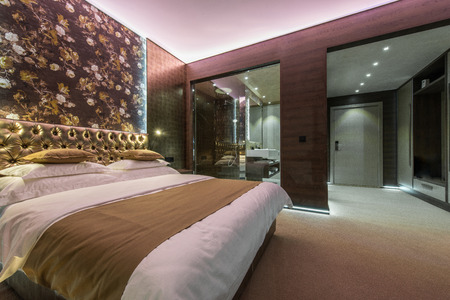 Luxury bedroom with bathroom in apartment or hotel