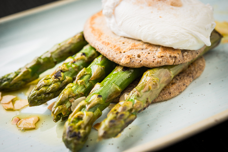 Close up of vegan meal made of pancakes and asparagus Stock Photo
