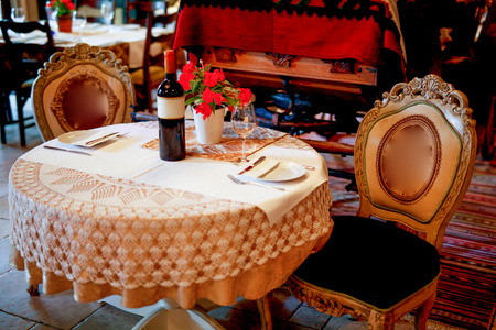 Antique Style Decorated Table For Two In Luxury Restaurant Stock - Table for two restaurant