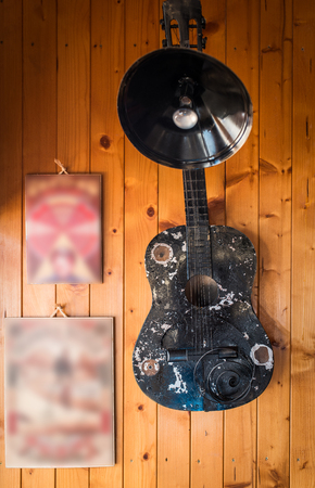 Lamp on wall made of guitar