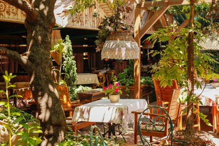 Vintage decorated patio with tables in restaurant