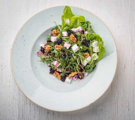 Top view of vegan salad over rustic white table