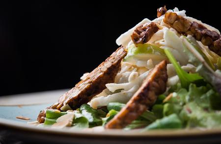 Vegan delicious salad over black background