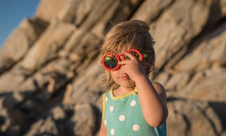 Retro portrait of little girl and sea rock is back
