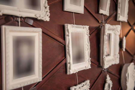 Decorative old fashioned frames on wall in restaurant interior