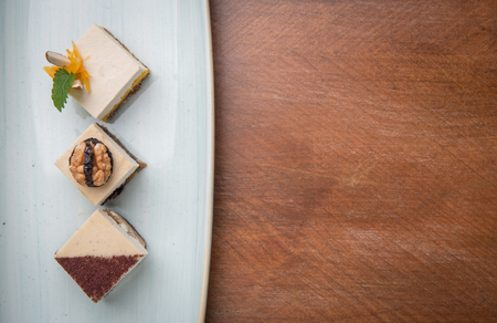 Vegan cakes in plate over wood with space for your text