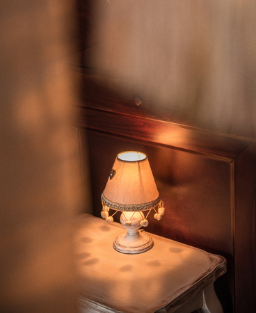 Antique lamp on table in interior of home or restaurant
