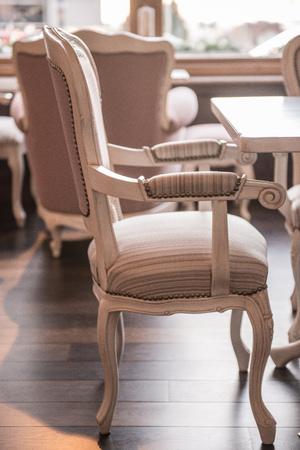 Antique style armchair in luxury restaurant interior