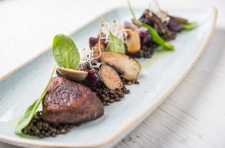 Vegan dish top view over retro wood with copy space, portobello mushrrom 版權商用圖片