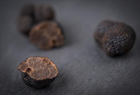 Black truffle mushrooms over rustic gray table