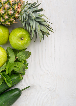 Fruit background, pineapple apple cucumber on rustic wood with copy space 版權商用圖片